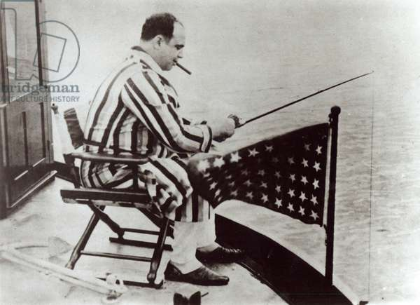Al Capone (1899-1947) fishing on his yacht (b/w photo)