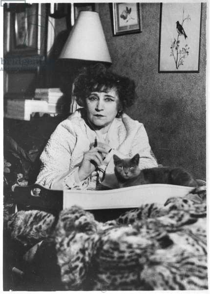 Colette (1873-1954) with her cat (b/w photo)