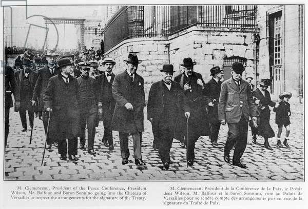 Georges Clemenceau (1841-1919) President of the Peace Conference, President Woodrow Wilson (1856-1924) Arthur James Balfour (1848-1930) and Baron Sidney Sonnino (1847-1922) going into the Chateau of Versailles to inspect the arrengements for the signature of the treaty, from 'The Continental Daily Mail', 1919 (b/w photo)