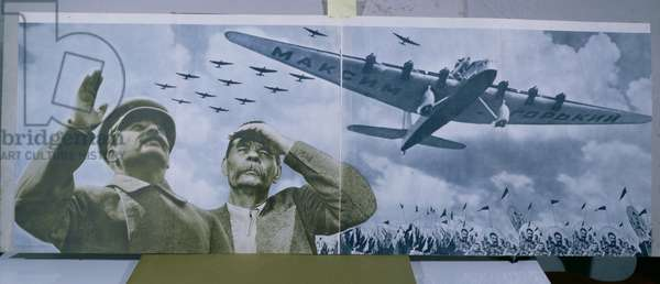 Joseph Stalin (1879-1953) & Maxim Gorky (1868-1936) observing an aeroplane bearing the name of the writer, illustration from 'L.U.R.R.S. en construction', January 1935 (coloured photo)