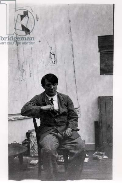 Pablo Picasso (1881-1973) in his studio, rue Schoelcher, 1914 (b/w photo)