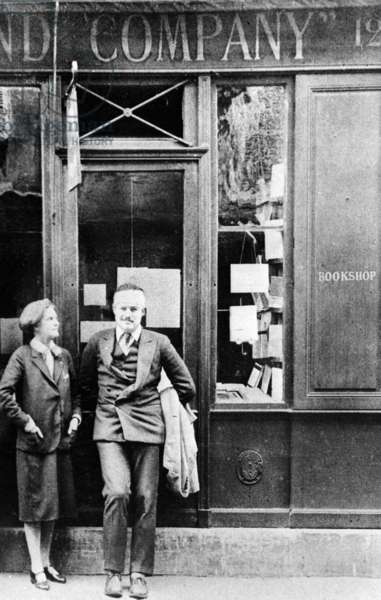 Sylvia Beach and Ernest Hemingway in front of Shakespeare and Company Bookshop, c.1928 (b/w photo)