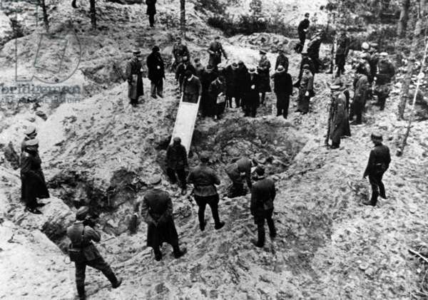 Excavation of Mass Graves in the Katyn Forest, 1943 (b/w photo)