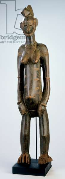 Female figure, from the Ivory Coast, later 19th or early 20th century (wood)