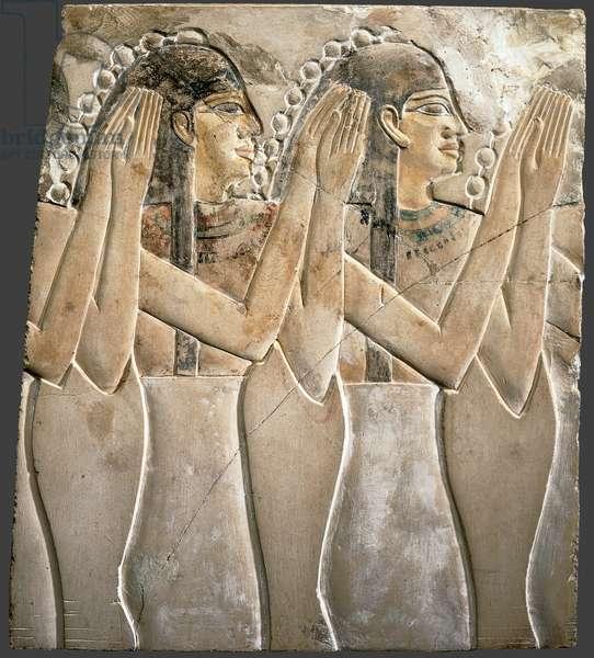 Female attendants clapping hands (limestone & pigment)