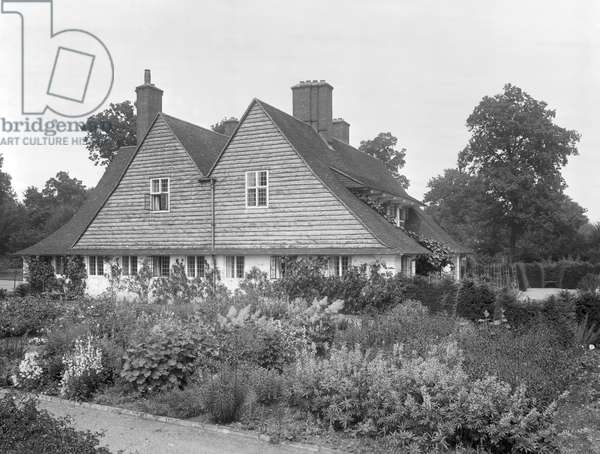 The twin-gabled, weather boarded side elevation of Homewood, from 'Edwin Lutyens: Country Houses' (b/w photo)