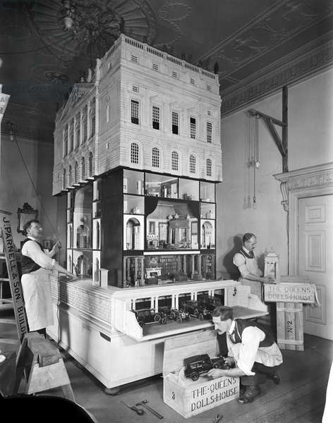 Removal men packing up Queen Mary's Dolls' House, 1924 from 'Edwin Lutyens: Country Houses' (b/w photo)