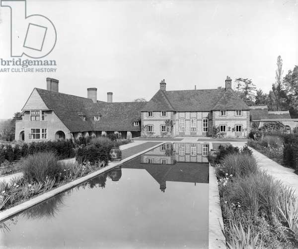 View of the exterior of Folly Farm and the Dutch formal canal garden from the south, from 'Edwin Lutyens: Country Houses' (b/w photo)