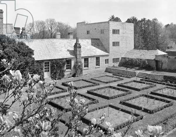 Looking over the garden to Lutyens' new south wing and tower at Penheale Manor, from 'Edwin Lutyens: Country Houses' (b/w photo)
