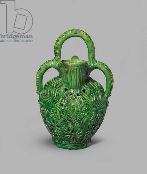 Green-glazed puzzle jug with pierced design including a mask and figure of Justice with a lion rampant on medallions, 1600-99 (tin-glazed earthenware (maiolica))