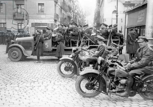 Trucks moving soldiers during the Spanish Civil War. Photography. SPAIN. Madrid