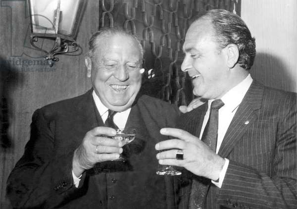 Bernabeu Yeste, Santiago (1895-1978). Footballer and President of Real Madrid. He is one of the most important men in Real Madrid's history. He has been the only president who has been in charge of the Real Madrid team for 35 years until his death. Di Stefano, Alfredo (1926-2014). Argentina footballer and coach, who has been called the best, most complete and influential footballer of all time. Santiago Bernabeu and Alfredo Di Stefano during the inauguration of a coffee shop owned by Ferenc Puskas. Madrid, 04/13/1967. Photography. SPAIN. Madrid
