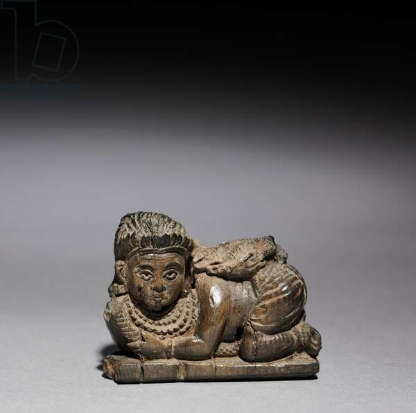 Figurine of a Crouching Woman, 900-800 BC (ivory)