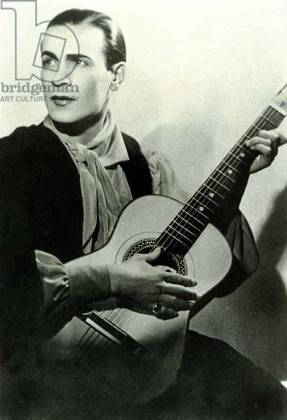singer Tino Rossi playing guitar around 1935
