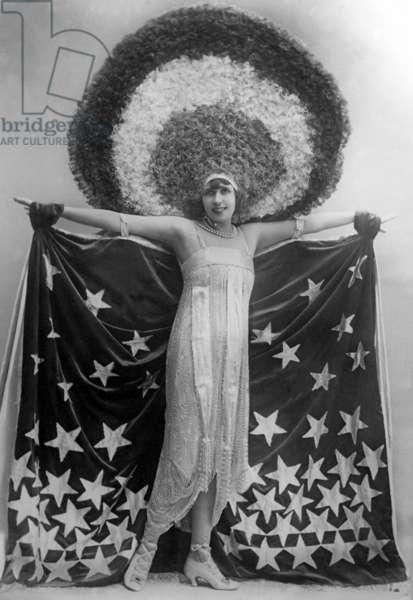 Mistinguett wearing giant headgear in her show in Paris, 1917