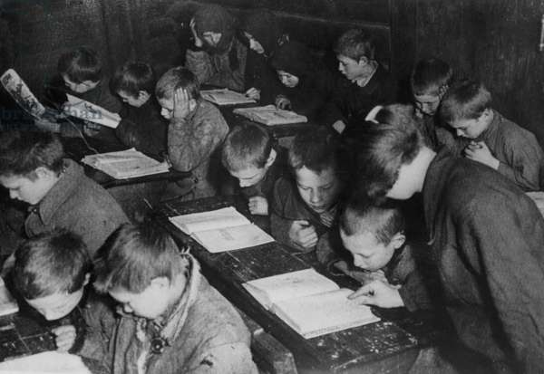 School in a Soviet village in the 30's, in the background two adult women attending the training course
