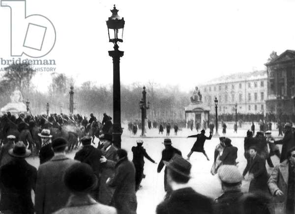 Demonstrators throwing stones at guards on Concorde square in Paris on february 6, 1934 : march of the Right during Stavisky affair