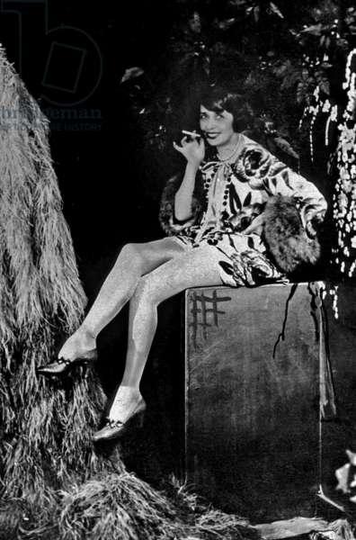 Mistinguett (1875-1856) smoking c. 1928