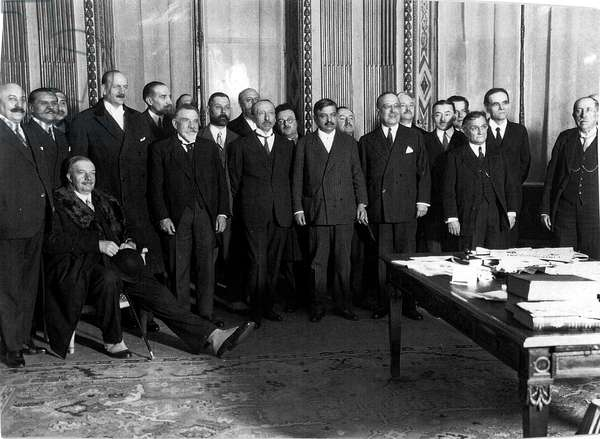 Pierre Laval (standing in the center with striped suit) and the members of his government