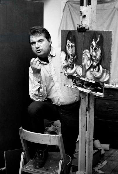 Francis Bacon with self portrait (b/w photo)
