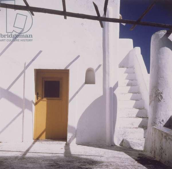 Yellow Door in White Building