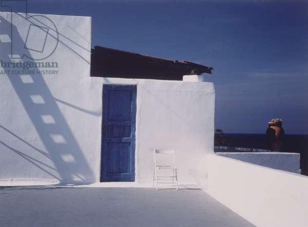 Blue Door in White Building