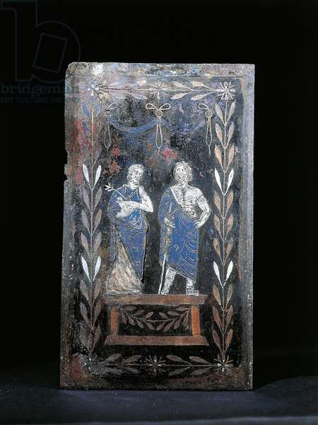 Bronze cover of medical kit depicting Asclepius and Hygieia surrounded by laurel leaves, from Herculaneum