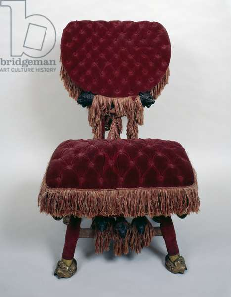 Chair upholstered in red velvet and fringing, by Antoni Gaudi (1852-1926), Art nouveau style (modernism). Spain, 20th century.