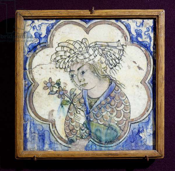 Tile decorated with young man holding bouquet of flowers, ceramic, Persia, 17th century
