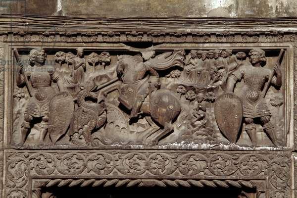 St George on horseback slaying dragon that was terrorizing Christianity, lintel decorated in relief, by Giovanni Gaggini (1470 circa-1517), Doria-Quartara Palace or Giorgio Doria Palace, Genoa, Liguria, Italy, 15th century