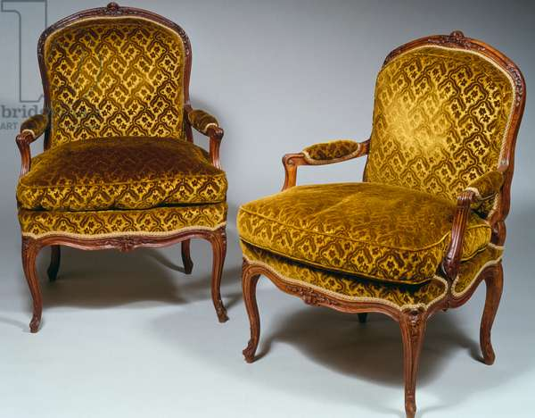 Pair of Louis XVI style backrest armchairs, in waxed, molded and carved natural wood, with flowers and acanthus leaves; armrests and arched legs, stamped by IB Boulard, 90,5x66,5x56cm, France, 18th century
