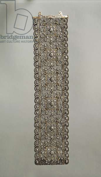 Lace pattern gold and silver band bracelet set with diamonds, by Mario Buccellati, 1920s.