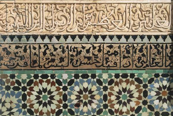 Mosaic and carvings on a wall, Ali Ben Youssef Medersa, Marrakesh, Morocco