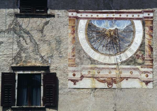 Sundial on wall of house in Sarnonico, Val di Non, Trentino-Alto Adige, Italy