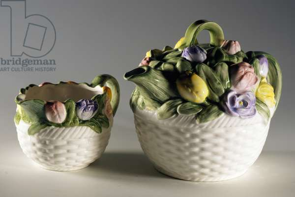 Collectible teapot and milk jug with relief floral decoration, ceramic, England, 20th century.