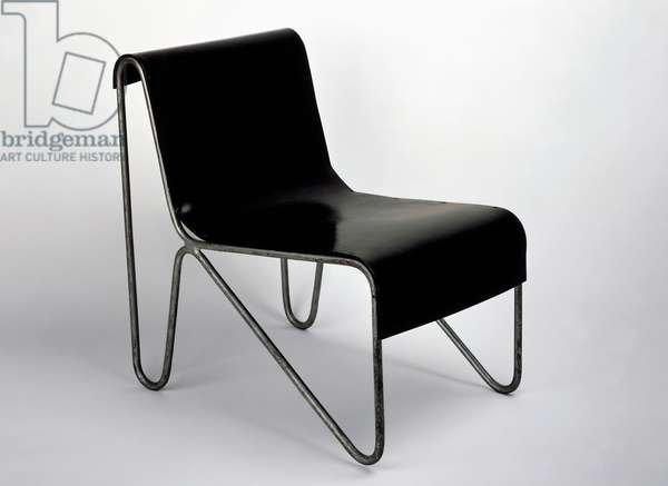 Armchair, by Gerrit Thomas Rietveld (1888-1964), in steel and wood. The Netherlands, 20th century.