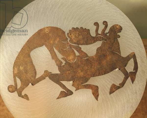 Ornament depicting a tiger tearing a moose