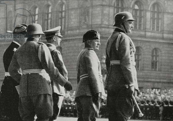 Duce Benito Mussolini (1883-1945) attend armed forces parade in Berlin, Germany, with Adolf Hitler, Marshal Werner von Blomberg (1878-1946), Admiral Erich Raeder (1876-1960) and General Werner von Fritsch (1880-1939)