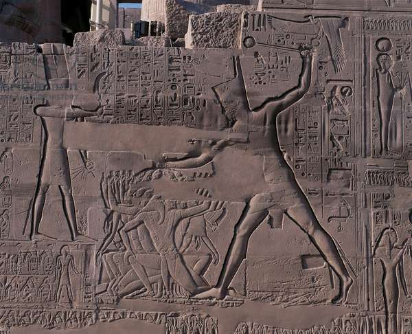 Egypt - Ancient Thebes (UNESCO World Heritage List, 1979). Luxor. Karnak. Great Temple of Amon - Great Hypostyle Hall (New Kingdom). Outer wall, north: reliefs showing the military campaigns of Seti I into Syria and Palestine (1304-1290 BC), detail