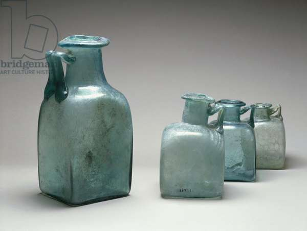 Four blue glass bottles, used as measures of capacity, from Pompei