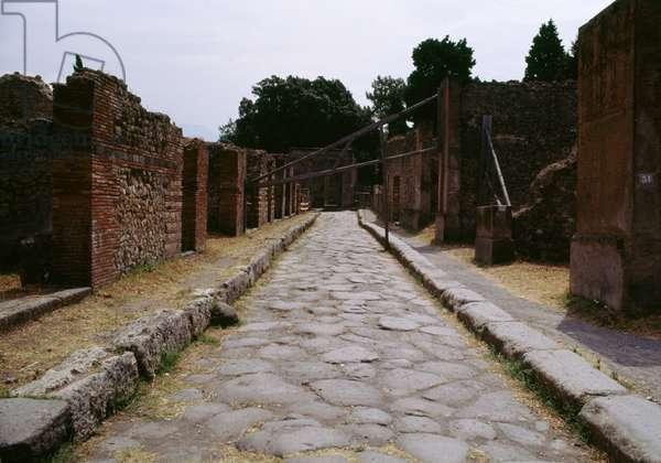Glimpse of a street in Pompeii (UNESCO World Heritage List, 1997), Campania, Italy. Roman civilization, 1st century AD
