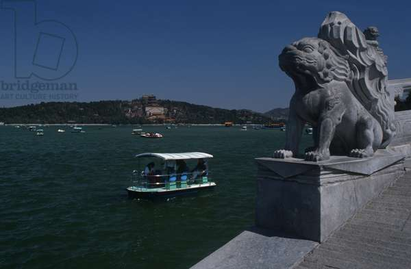 China, Beijing, Fengtai, Kunming Hu lake from Marco Polo Bridge with Imperial Summer Palace in background