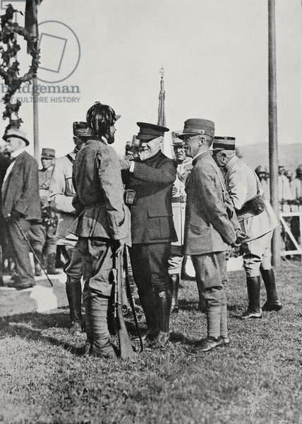 French President Raymond Poincare pinning a medal on a rifleman in the presence of the King of Italy, Vittorio Emanuele III, Italy, World War I, from L'Illustrazione Italiana, Year XLIV, No 33, August 19, 1917