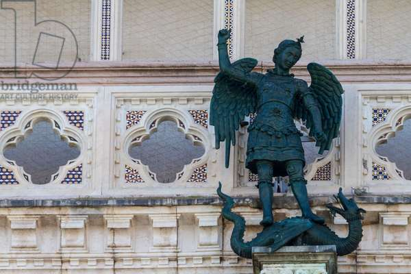 St Michael archangel and dragon, bronze sculpture (copy) by Matteo Ugolino from Bologna, 1356, facade of Orvieto cathedral, Italy, 14th century