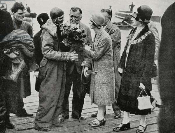 Amelia Earhart being received in Southampton, United Kingdom, after her transatlantic flight, from L'Illustrazione Italiana, Year LV, No 27, July 1, 1928