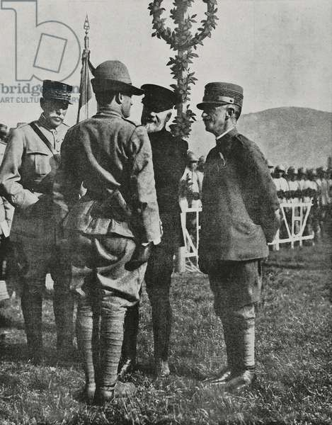 President of French Republic Raymond Poincare (1860-1934) decorates captain of Italian Alpini before Victor Emmanuel III (1869-1947), King of Italy, photograph from magazine L'Illustration, year 75, no 3886, August 25, 1917