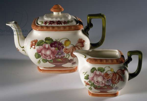 Collectible teapot and milk jug with floral decoration, ceramic, France, 20th century