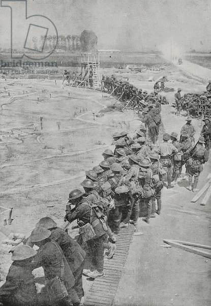 Australian soldiers studying huge raised-relief map to plan attack of Messines, Third Battle of Ypres, Belgium, First World War, photograph from magazine L'Illustration, year 75, no 3897, November 10, 1917