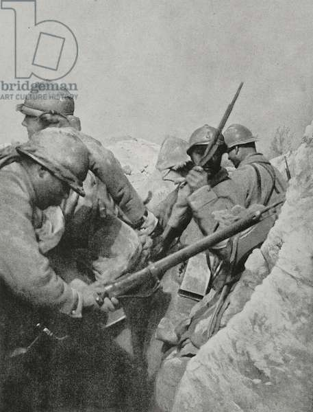 Infantrymen reloading their rifles waiting for German counterattack, May 6, 1917, Chemin des Dames, France, Second Battle of Aisne, First World War, photograph from magazine L'Illustration, year 75, no 3872 May 19, 1917
