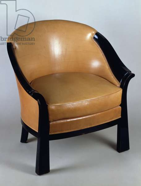 Art Deco style armchair, by Pierre Chareau (1883-1950), ebony and leather, France, 20th century